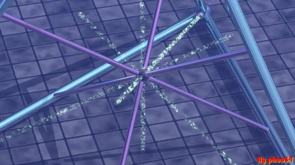 Particolare dello strumento laser in funzione, i raggi bombardano il campione di vuoto.